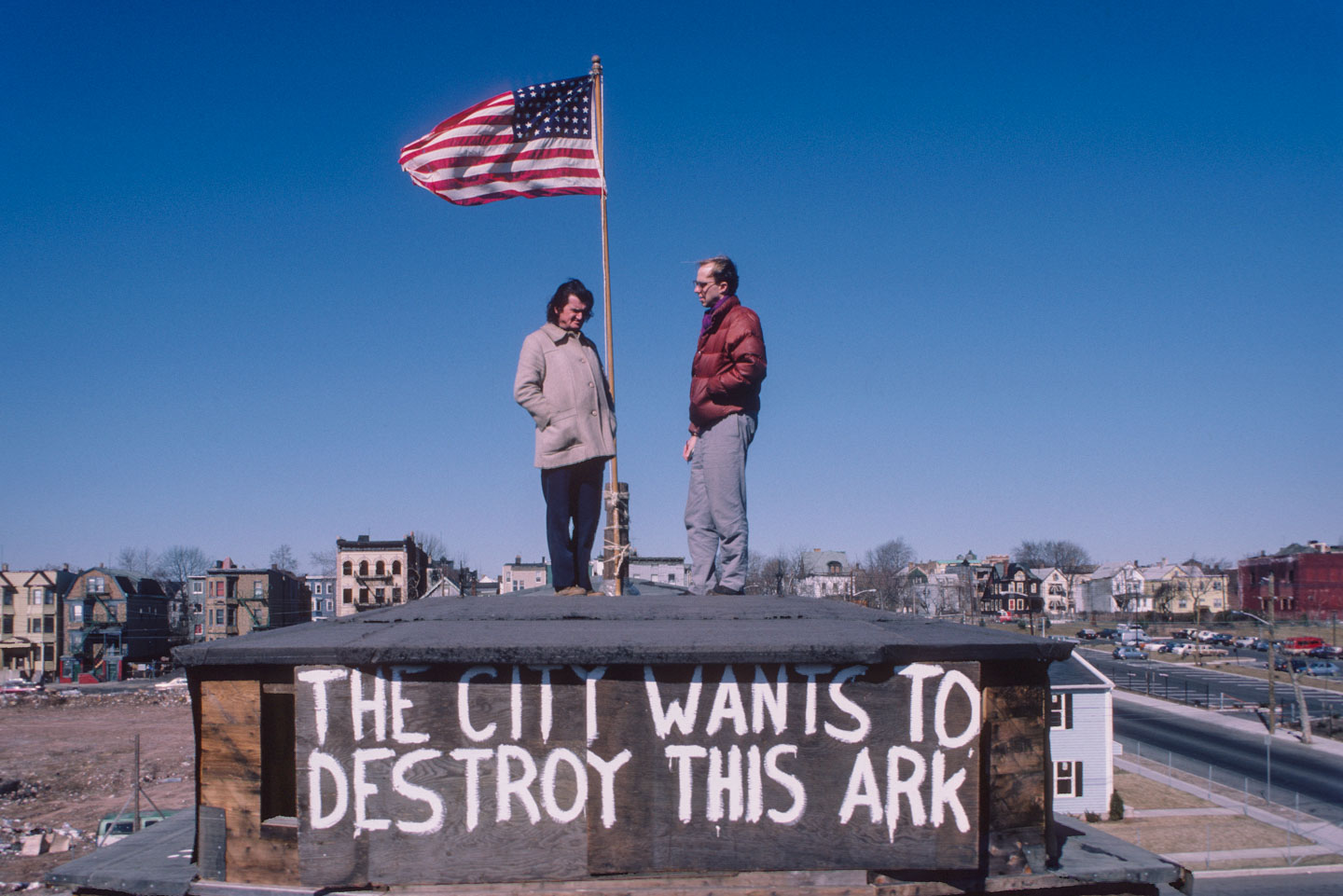 13-Kea speaking with Chip Brown of the Washington Post on the deck of the Ark, Bergen St. at 14th Ave., Newark, 1987_
