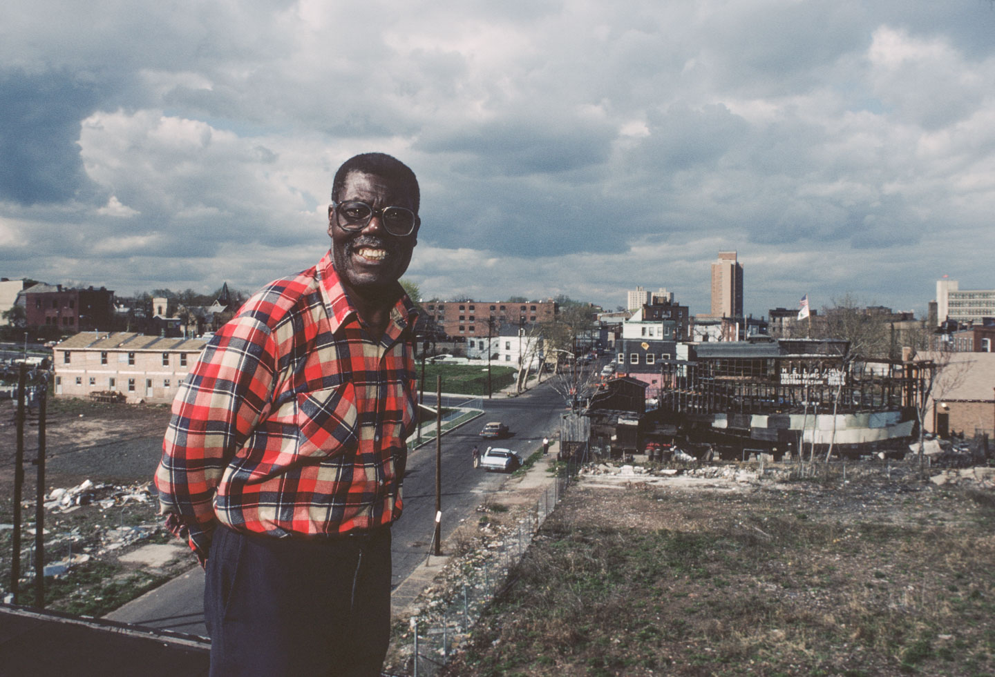 29-Tom Taylor standing on the roof of his Camden St. home, view towards 14th Ave., 1987_